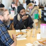 Homeless men enjoy a free lunch at Blanchet House in downtown Portland