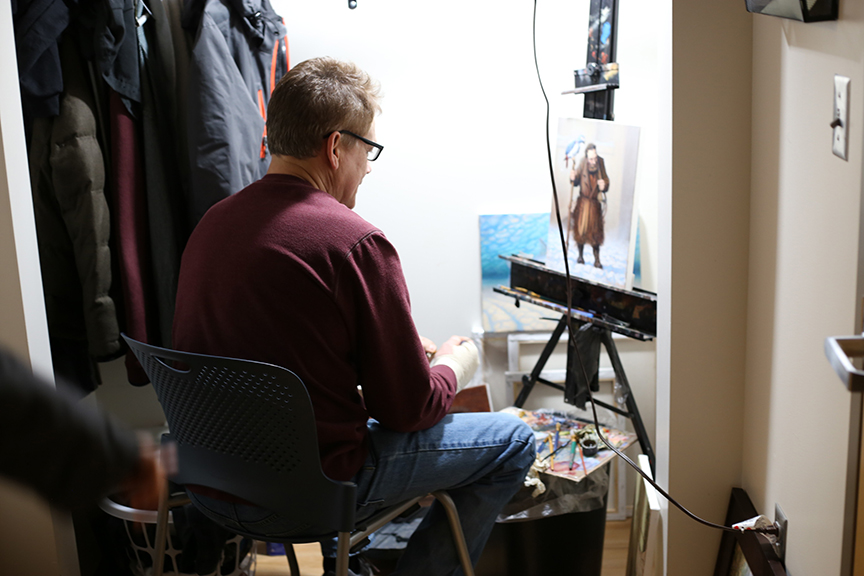 Artist Richard Lithgow painting in his closet at Blanchet House. credit Julie Showers