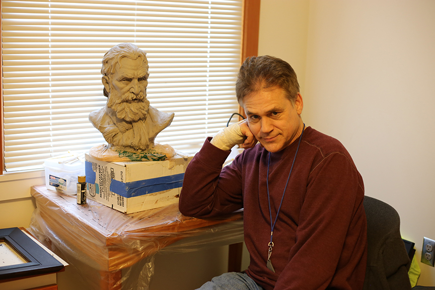 Artist Richard Lithgow poses next to a sculpture he made while staying at Blanchet House. credit Julie Showers