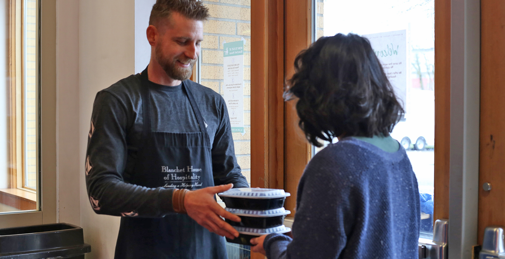 "March 16, 2020 Dear Blanchet House Community, Just yesterday, I wrote to you about our commitment to serve meals during the COVID-19 crisis. Today, Governor Kate Brown ordered all eateries like our Founders Café to close starting tomorrow. The order also bans public gatherings of more than 25 people, with the CDC recommending gatherings of no more than ten. While I endorse this move, I am sad that we have to close to perhaps the last indoor refuge remaining for our meal guests. But this doesn't mean we will stop serving meals! We will not abandon the hundreds of people who depend on us for food. Our kitchen staff will transition to preparing and packing to-go meals, which we will pass out at both entrances—NW 3rd Ave. and NW Glisan St.—so as to minimize lines and crowding. We will serve three times a day like we normally do; our hope is to provide as many hot meals as we can each day. We need your help to continue feeding people by doing the following: 1. Volunteer. Help pack to-go meals and run them to doors for handing out. Volunteers age 60 and over are still strongly encouraged to stay home, as well as any volunteers exhibiting any signs of illness. Email us at volunteer@blanchethouse.org if you want to help. 2. Purchase To-Go Containers and Forks. Containers will costs us approximately $33 per meal. Consider funding an entire day's worth of containers for $100. 3. Donate To-Go Food. Send via Amazon or drop off single-serving non-perishable food items or produce that we can use to supplement our to-go meals to help our meal guests stretch their food. 4. Collect Clothing. The nights are still very cold. We need warm adult-sized clothes to give to our meal guests. Shop our Amazon wish list. We also need volunteers to sort and organize clothing! Dorothy Day, the woman who inspired our mission said, ""Charity is a recognition of a person's dignity and the personal response that this dignity should inspire."" Each of us face challenging days filled with uncertainty and dizzying change. Our staff and volunteers will continue to meet these challenges, inspired by the dignity of the people we serve. These are days we will remember. Days filled with grace and charity. Scott Kerman Executive Director, Blanchet House of Hospitality"