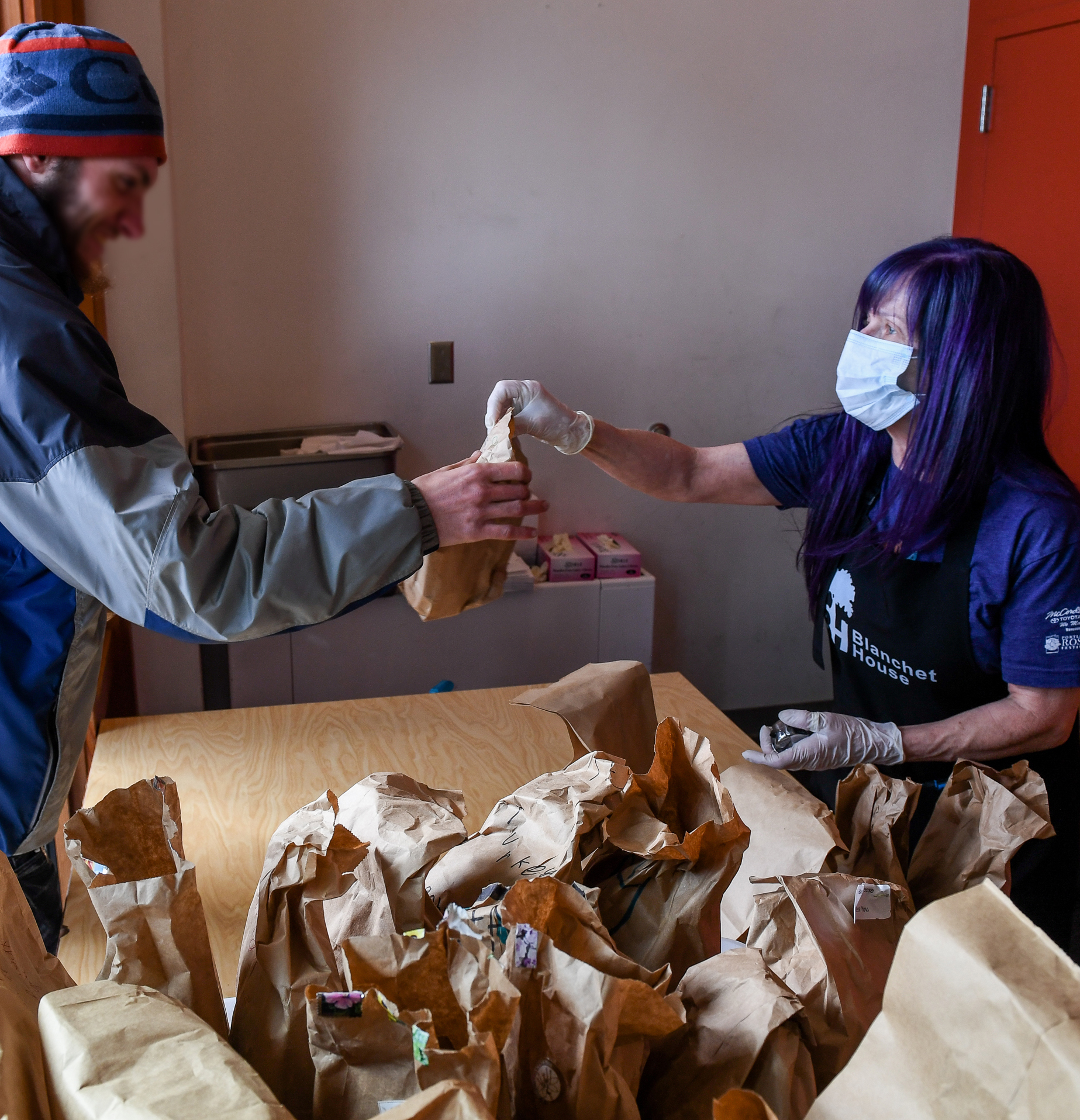 Josi Whitney volunteers to serve lunch at Blanchet House of Hospitality during the COVID19 pandemic in Portland, Oregon. Photo by Justin Katigbak.