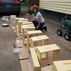 Katy building the bee boxes for Blanchet Farm at her home in Portland.