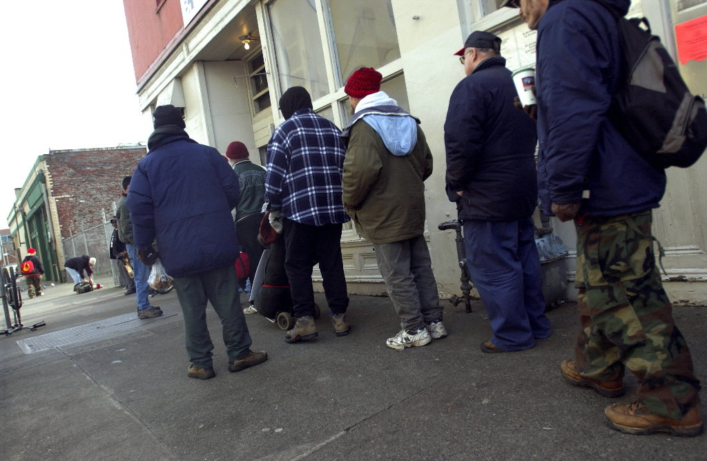 People wait in line for a meal outside Portland's Blanchet House of Hospitality in 2008.