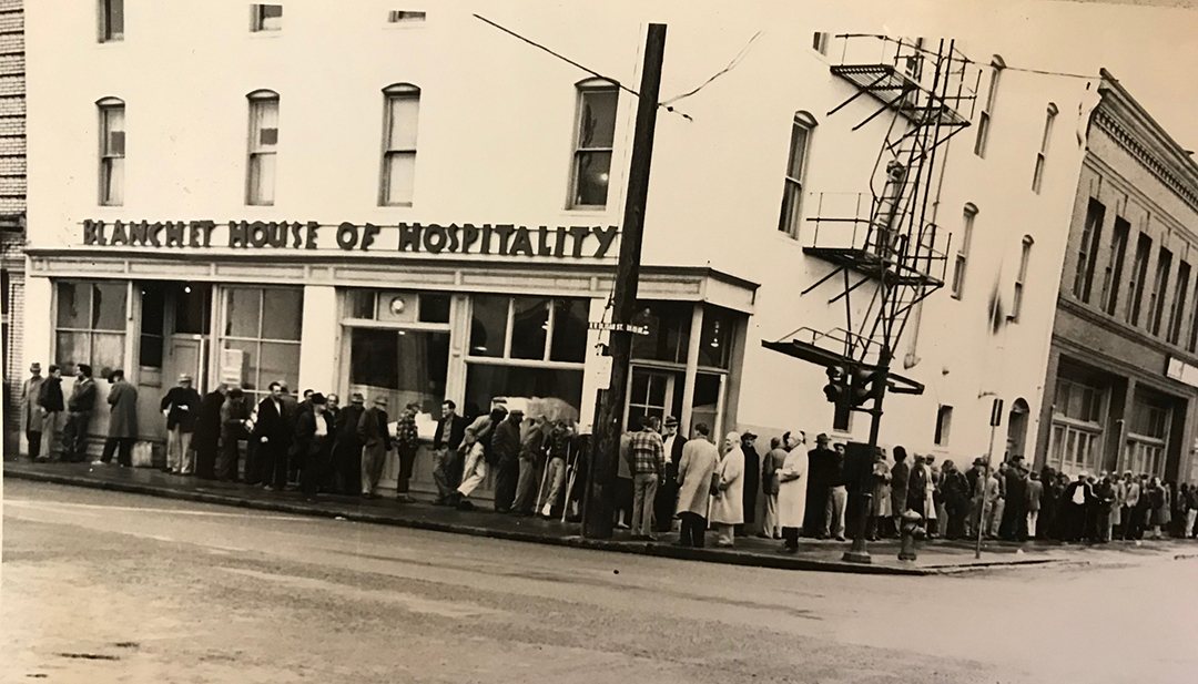 Guests line up for a hot meal at Blanchet House of Hospitality in 1959.