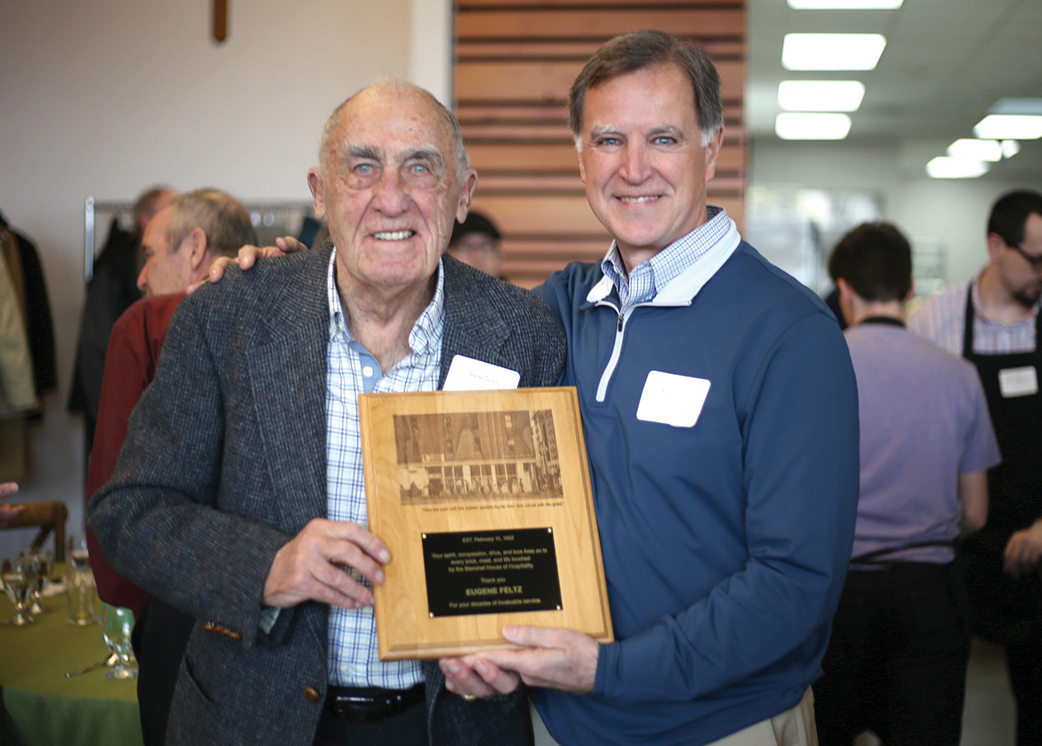 Steve Feltz, right, presents an award to his dad, Gene Feltz, at the annual Lend a Helping Hand Brunch in 2018.