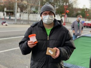 HomelessGuestwithLantern