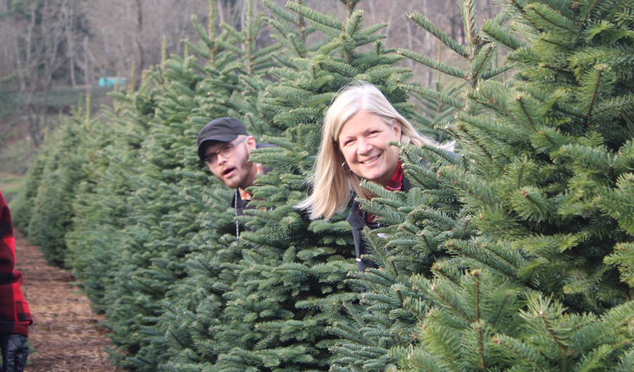 Erik Schram and Kristi Katzke picking out trees for Christmas at Blanchet House, circa 2019.