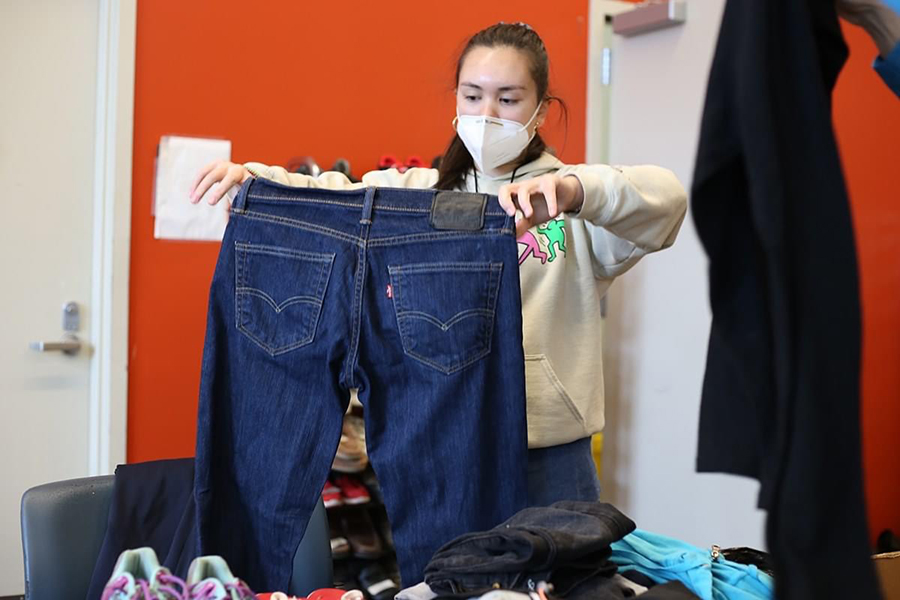 A volunteer sorts donated clothing at Blanchet House.