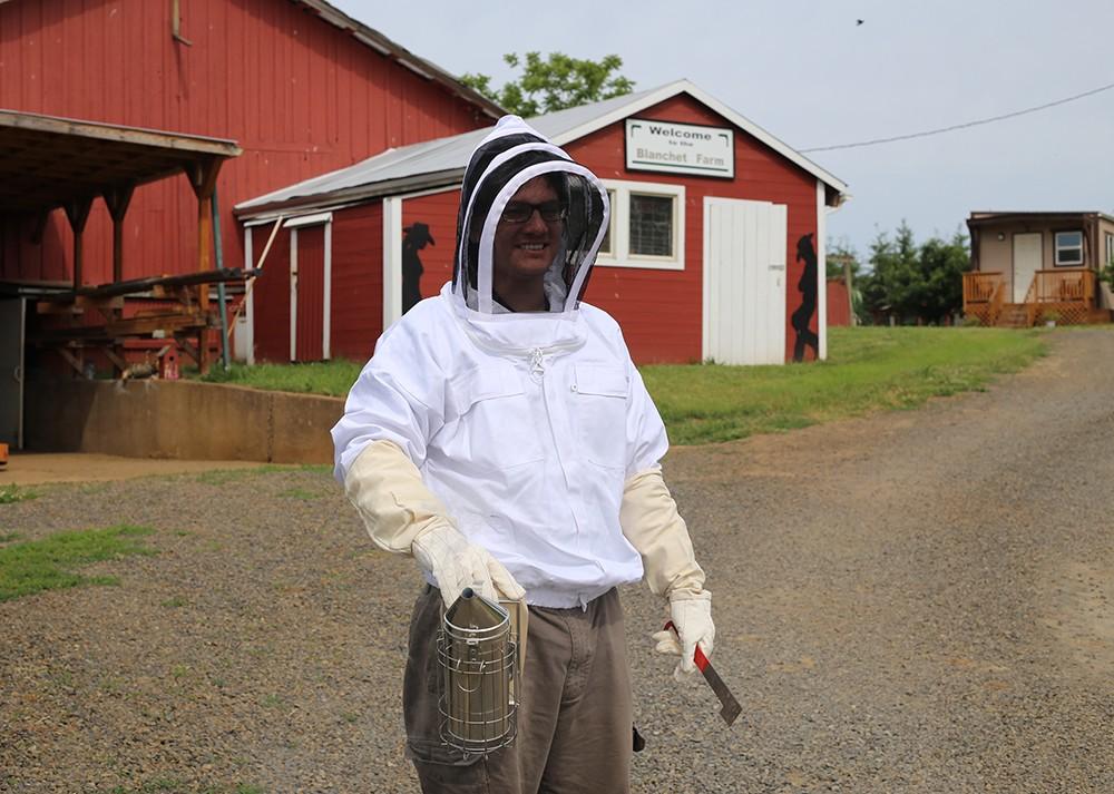 Jordan Shahrazi, a beekeeper in training, at Blanchet Farm. Photo by Julie Showers.