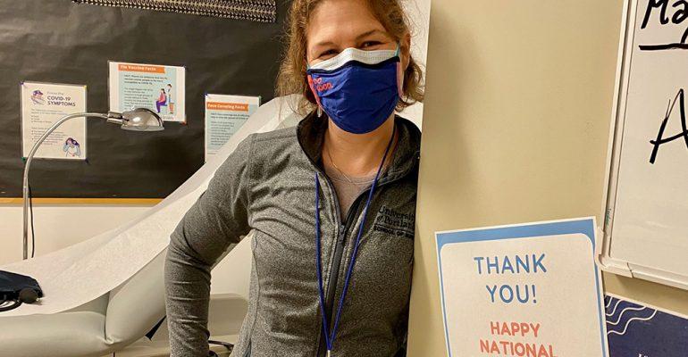 Nurse Amber stands in the door way of the HHC